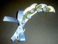 Blue Roses and Green Leaves on Rachetti with Blue Satin Ribbon